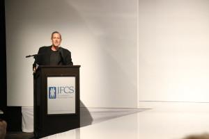 JFCS President Rob Feldman auctions an experience.